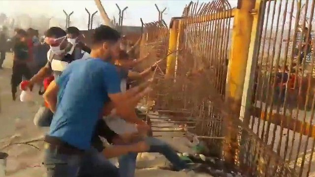 Several Palestinian rioters breaching the border fence near Kibbutz Zikim