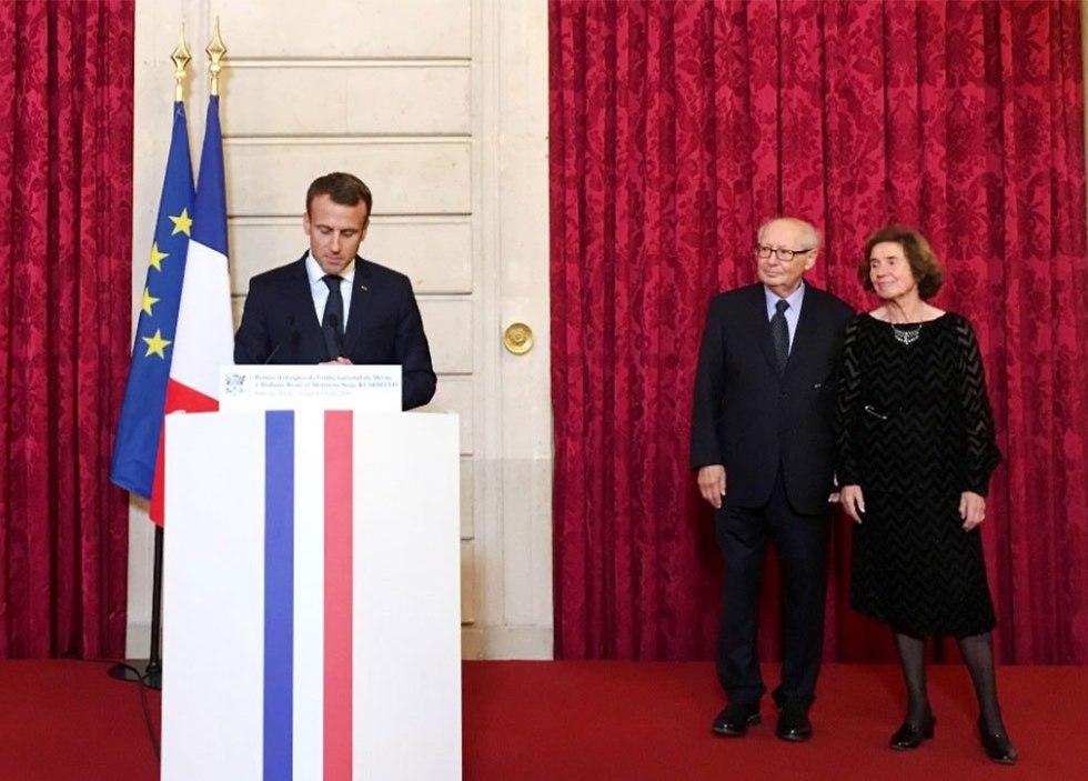 Emmanuel Macron giving the Klarsfeld's France's highest honours