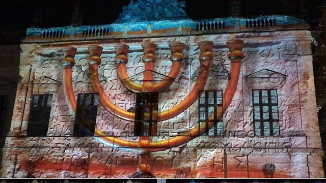 The audio-visual display, projected on the facade of the German Historical Museum.