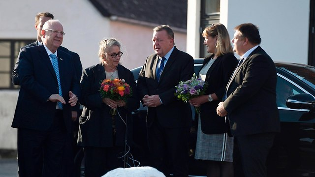 Rivlin and his wife at wreath laying event (Photo: AFP)