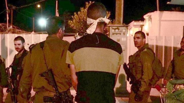 Terrorist after being captured (Photo: IDF Spokesperson's Unit)