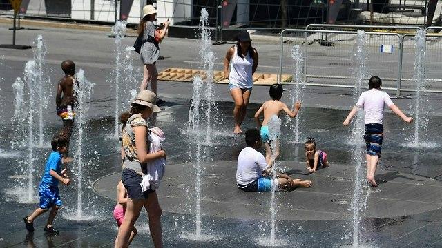 גל חום במונטריאול בחודש יולי (צילום: AFP)
