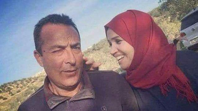 Aisha al-Rawbi and her husband