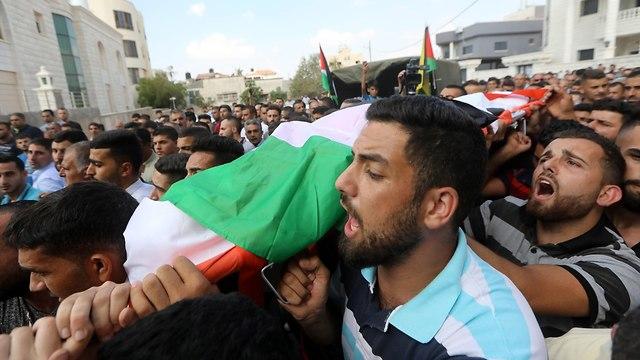 Funeral of Aisha al-Rawbi (Photo: EPA)