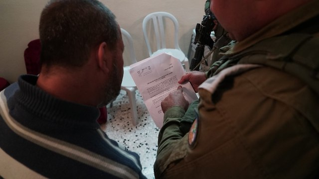 IDF soldiers delivering demolition order to Barkan terrorist's family. (Photo: IDF Spokesman's Office)