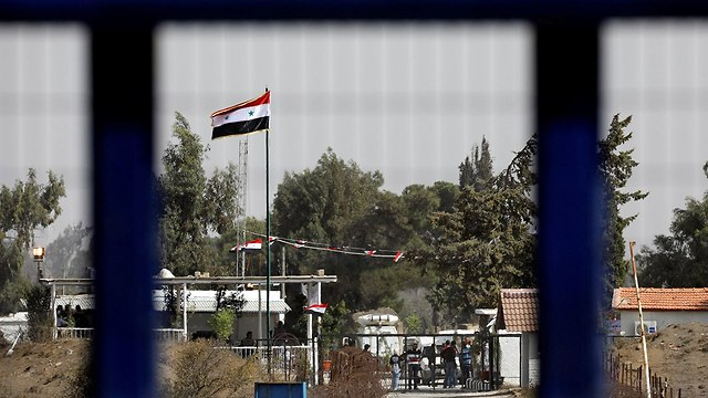 Syrian flag on the Israel-Syria border (Photo: Reuters)