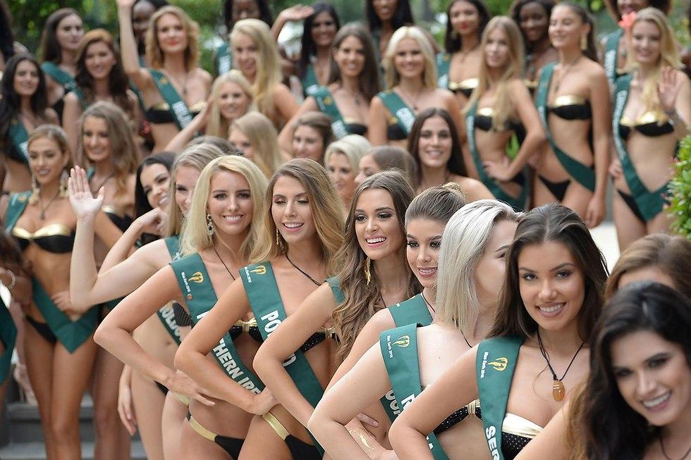 מתמודדות תחרות מיס כדור הארץ  (צילום: AFP)