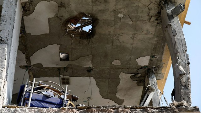 Damage caused to house in Be'er Sheva hit by rocket (Photo: Reuters)