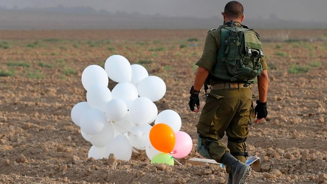 Incendiary balloons in Gaza border region (Photo: AFP)