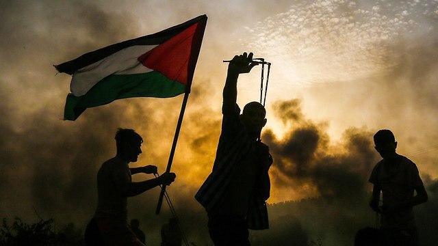 התפרעויות פלסטינים בגבול רצועת עזה (צילום: AFP)