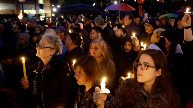 Vigil for victims of shooting (Photo: AP)