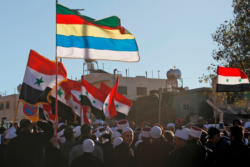 Druze and Syrian flags in Majdal Shams (Photo: AFP)