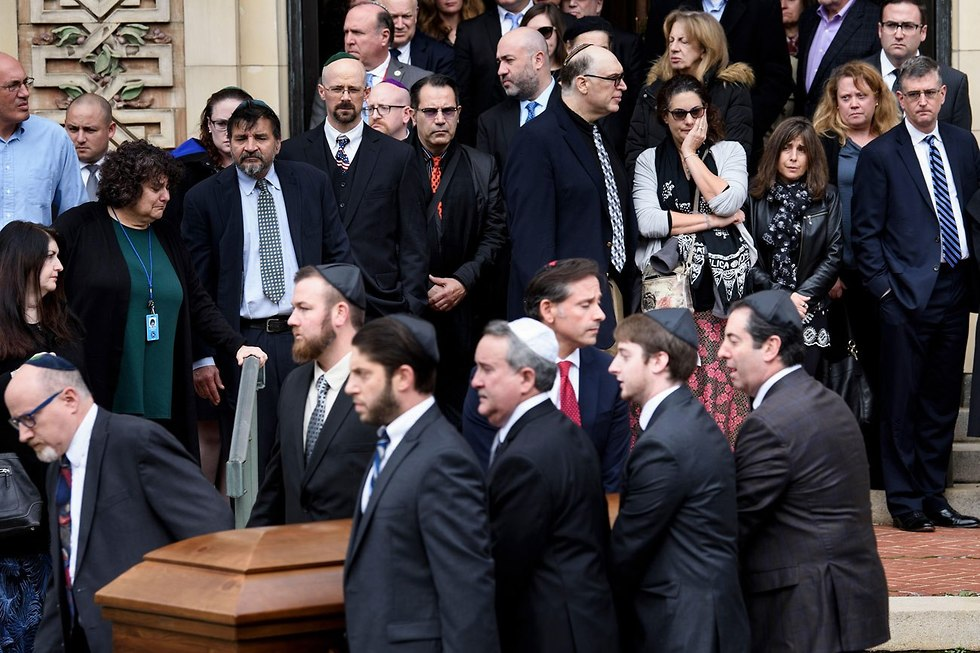 Funeral of brothers David and Cecil Rosenthal, who were murdered in the attack (Photo: AFP)