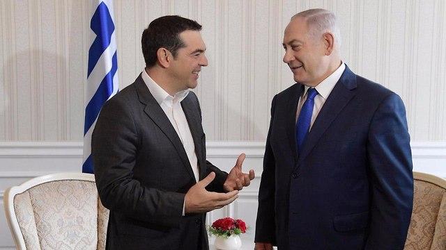 El primer ministro griego, Alexis Tsipras, con el primer ministro Benjamin Netanyahu (Foto: GPO) (Foto: GPO)