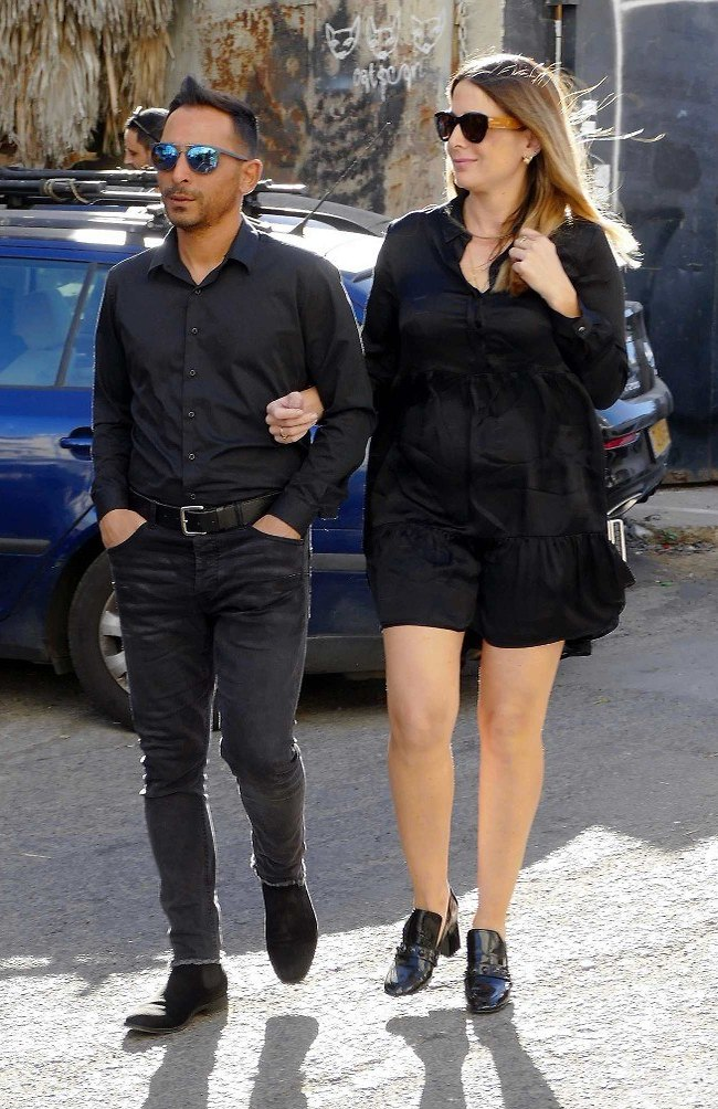לוהטים בשחור. מריאנו אילדמן ובת הזוג אידה (צילום: אמיר מאירי)