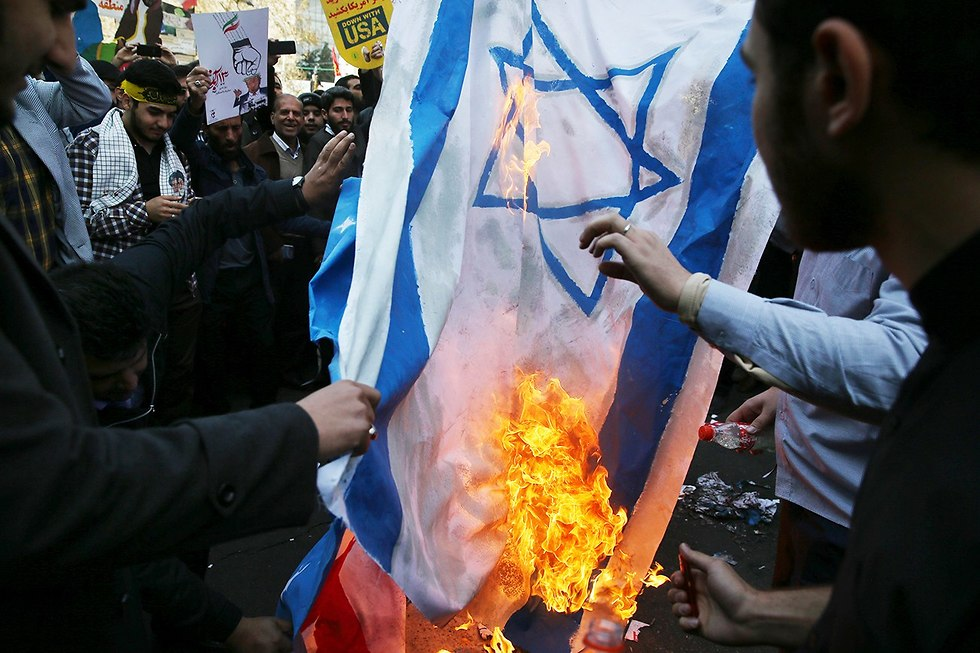 Iranians burning Israeli and American flags in Tehran to mark US Embassy takeover during 1979 Revolution (Photo: AP)