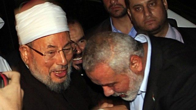 Шейх Аль-Кардави и Исмаил Хания в Газе. Фото: AFP