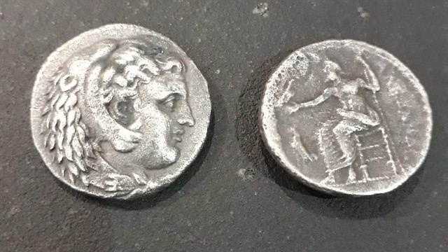 The silver coins confiscated. (Photo: COGAT)