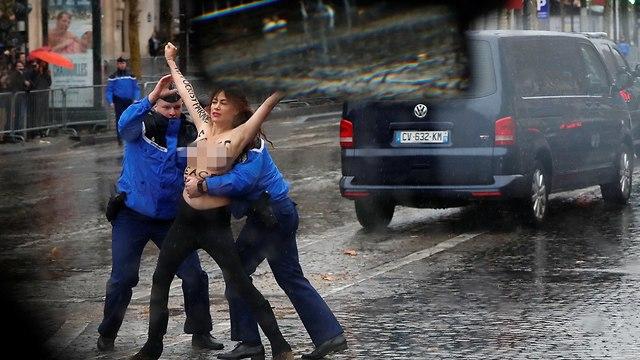 פעילה פמיניסטית FEMEN התפרצה ליד שיירה דונלד טראמפ טקס פריז מלחמת העולם הראשונה (צילום: רויטרס)