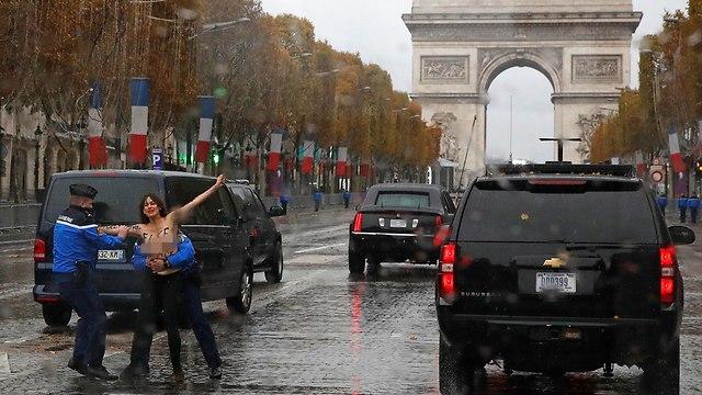 FEMEN protesters disrupt Trump's motorcade at WW1 event (Photo: AP)