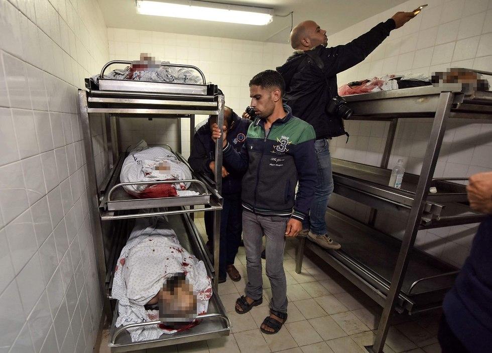 גופות ההרוגים בעקבות התקיפה ברצועת עזה (צילום: AFP)