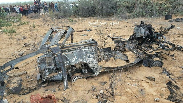 Remains of the vehicle used by the force after it was bombed by the IAF