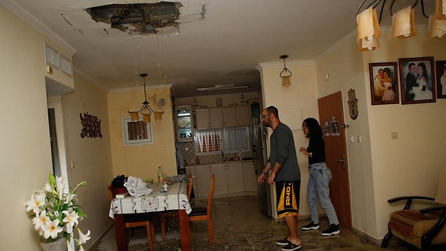 A home in Ashkelon hit by a rocket (Photo: AFP)