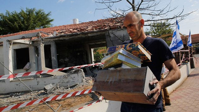 Ashkelon house that suffered direct rocket hit (Photo: AFP)