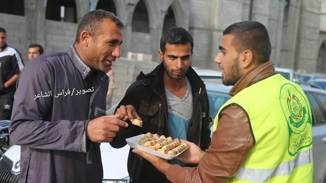 Sweets handed out in Rafah to celebrate Lieberman's resignation
