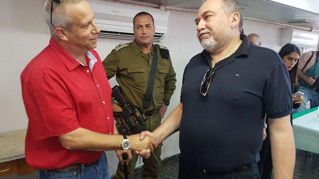 Head of the Eshkol Regional Council Gadi Yarkoni (L) and defense minister Lieberman