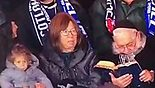 Rabbi Zev Leff reading Gemara during Israel-Scotland match