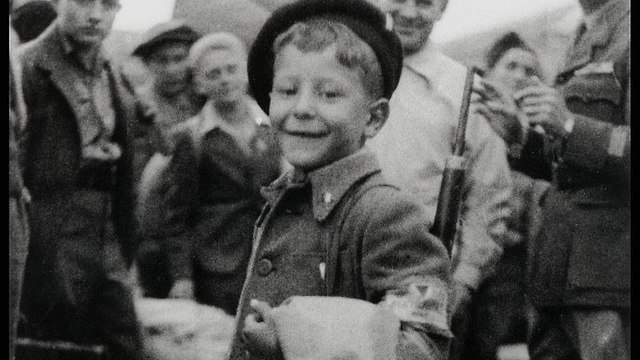 8-year old Yisrael Meir Lau leaving Buchenwald concentration camp after its liberation.
