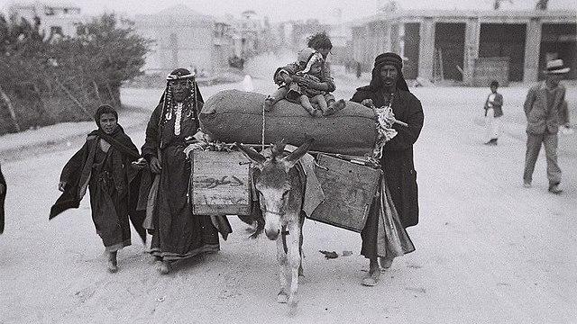Bedouin family passing through Tel Aviv