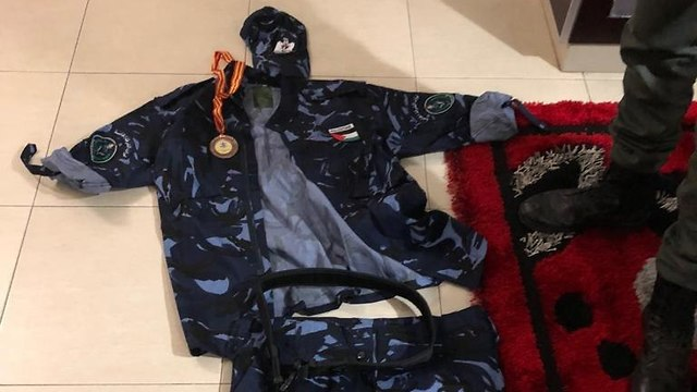 Uniform seized during searches of the suspects' homes