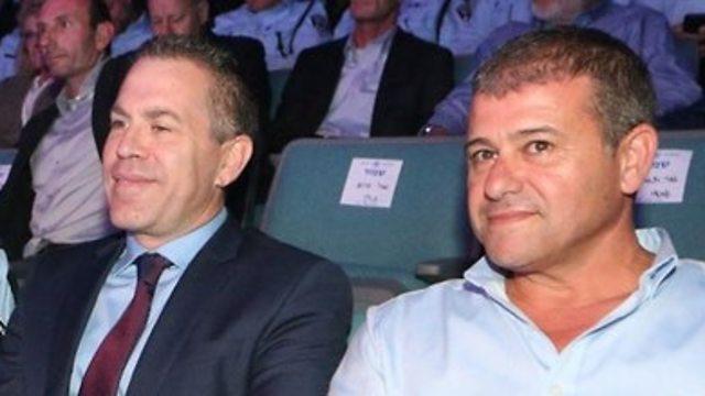 Public Security Minister Gilad Erdan (L) and Moshe 'Chico' Edri