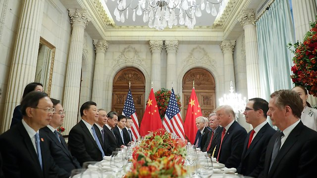 דונלד טראמפ ושי ג'ינפינג בוועידת ה-G20 (צילום: AP)