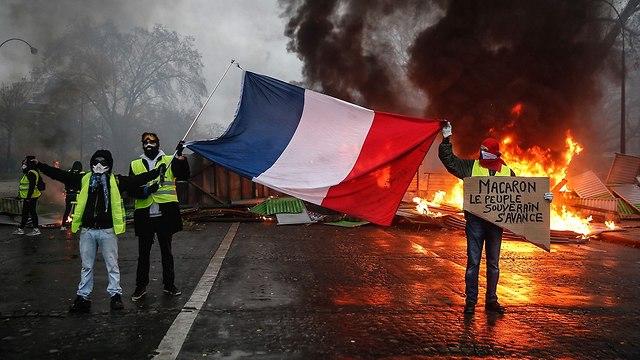 ההפגנה על יוקר המחייה בפריז (צילום: AFP)