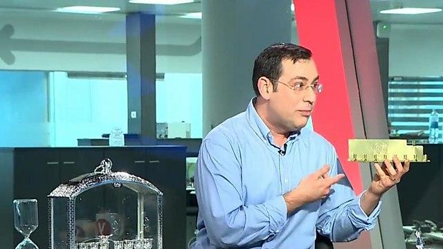 למען האיזון והפרופורציה - יצחק טסלר מציג: חנוכייה בשקל ()