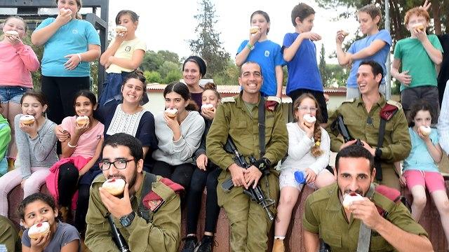 IDF soldiers meet with children near the Gaza border ahead of Hanukkah (Photo: Haim Horenstein)