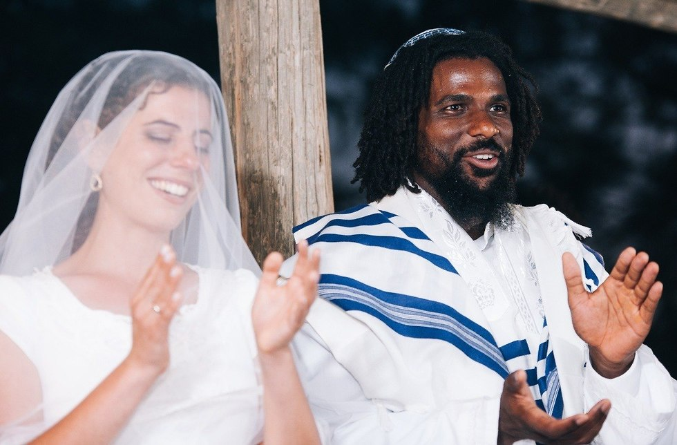 David Ben Moshe, right, and his wife Tamar Gresser on their wedding day