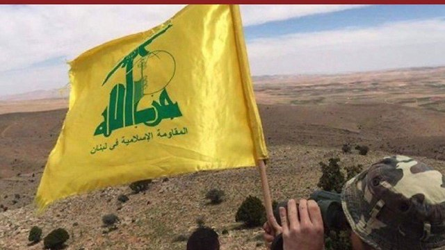 Hezbollah flag on the Israel-Lebanon border