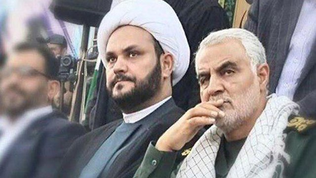 Akram al-Kaabi, left, the head of an Iraqi Shiite militaia, with Quds Force commander Qassem Suleimani