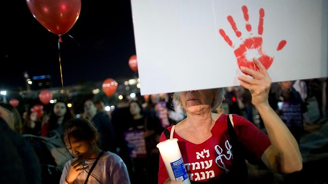 Demonstrators at Rabin Square protest against domestic violence (Photo: AP)