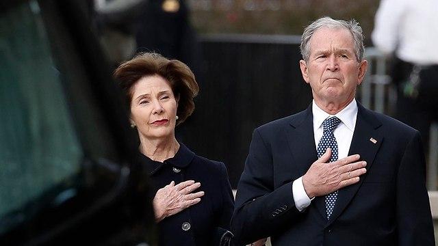 גורג' בוש ולורה בוש (צילום: AFP)