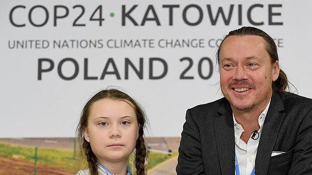 גרטה טונברג ואביה בוועידת האקלים (צילום: AFP)
