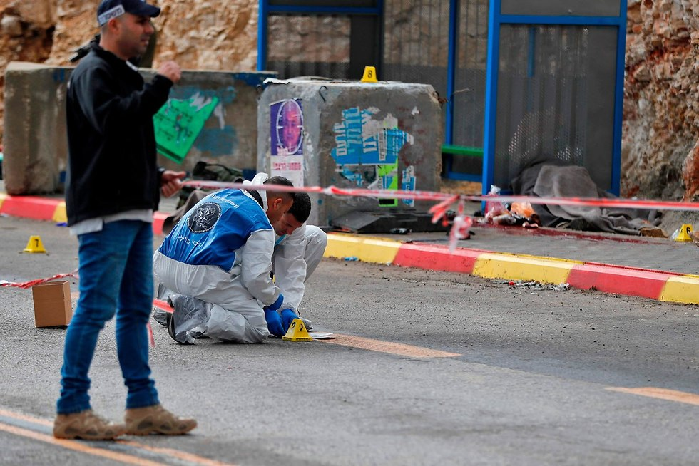 The scene of the attack at Giv'at Asaf (Photo: AFP)