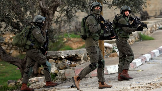 זירת הפיגוע בגבעת אסף בנימין (צילום: רויטרס)