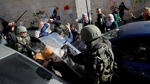 חגיגות 31 להיווסדו של ארגון חמאס (צילום: רויטרס)