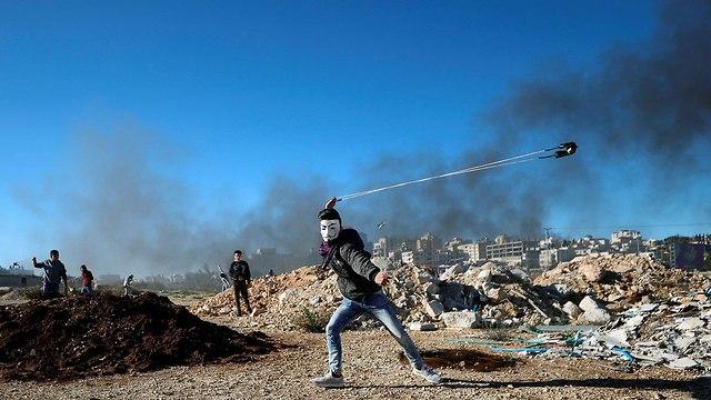 מנגנוני הביטחון הפלסטינים מונעים מחמאס לקיים עצרת בחברון לרגל יום השנה ה-31 לייסוד הארגון (צילום: רויטרס)