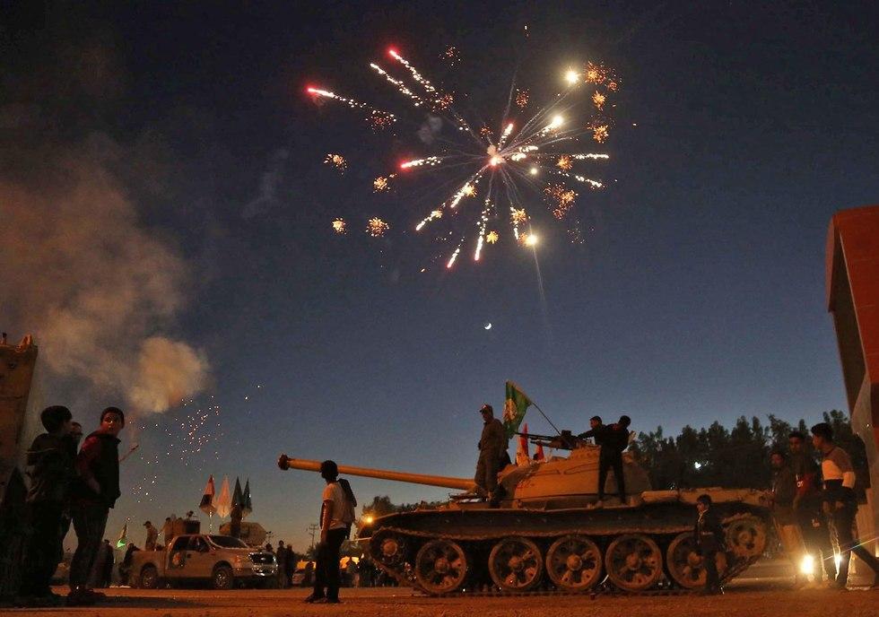 עיראק שנה לניצחון על דאעש חגיגות בעיר כרבלא (צילום: AFP)